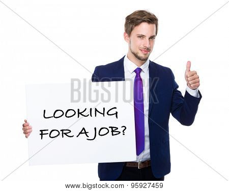 Businessman with thumb up gesture and holding placard showing phrase of looking for a job