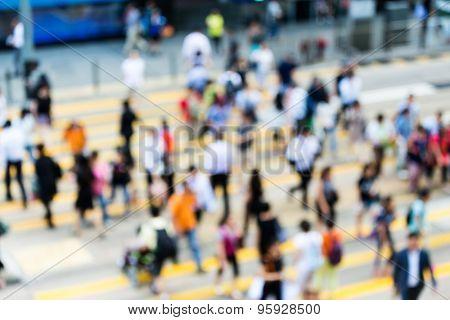 City cross walk is littered with pedestrians