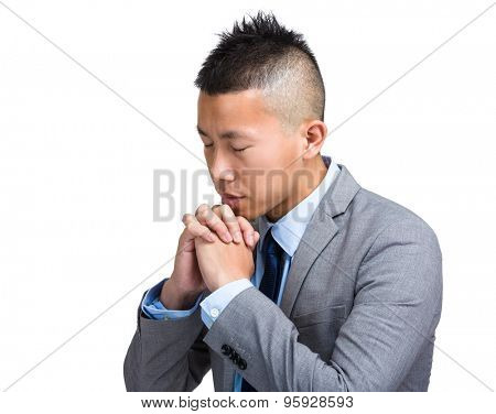 Young Businessman praying to the lord