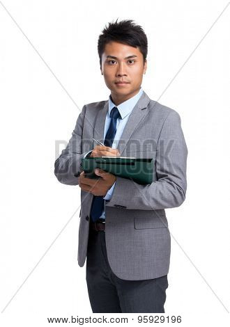 Businessman write on clipboard