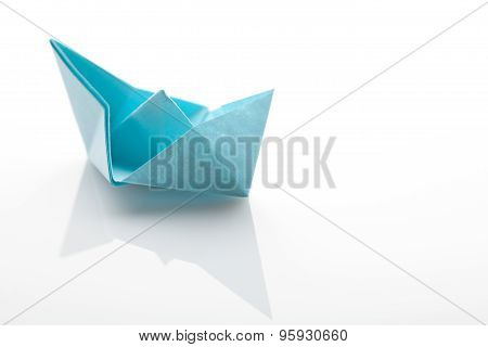 Origami paper ship on white background