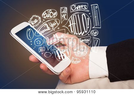 Hand holding phone with hand drawn speech bubbles concept