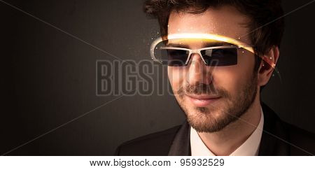 Handsome man looking with futuristic high tech glasses concept