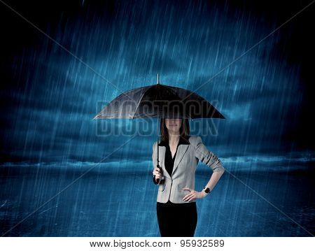 Business woman standing in rain with an umbrella concept on background