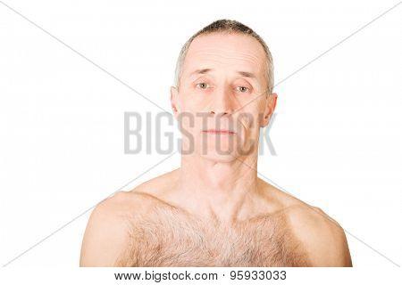 Serious shirtless old man looking at camera