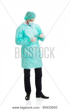 Handsome male surgeon doctor holding a syringe.