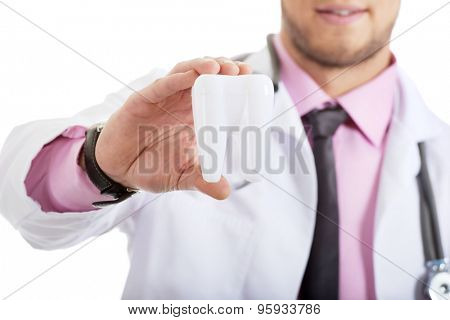 Male dentist holding  tooth model.