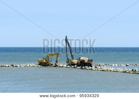 USTKA - JULY 07: Workers are building an artificial reef to facilitate the construction of the beach on 7 July 2015 in Ustka, Poland.