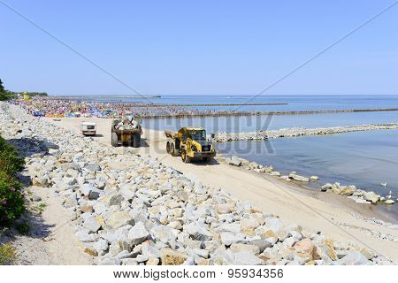 USTKA - JULY 04: Workers are building an artificial reef to facilitate the construction of the beach on 4 July 2015 in Ustka, Poland.
