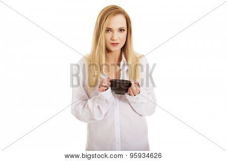 Beautiful woman in long sleeve shirt drinking coffee.
