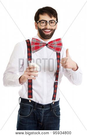 Funny man wearing suspenders with ok sign and glass of milk.