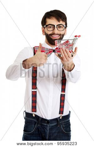 Fashionable man with small shopping basket and thumbs up..