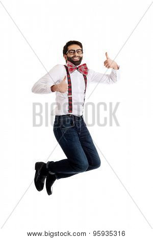 Funny man wearing suspenders jumping with thumbs up.