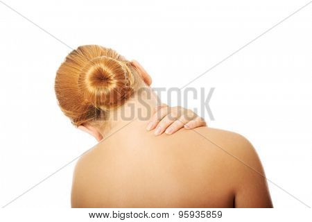 Overweight woman suffering from neck pain.