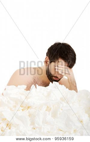 Sick man with a lot of tissues.
