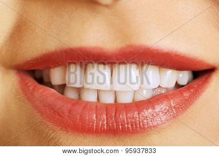 Beautiful young female white teeth.