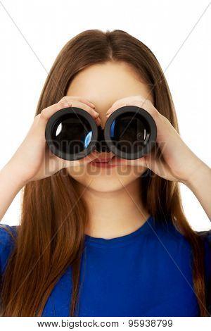 Beautiful teenage woman with binoculars.