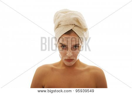 Confident woman with cream lotion on face