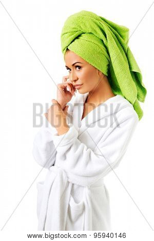 Spa woman in bathrobe and towel on head.