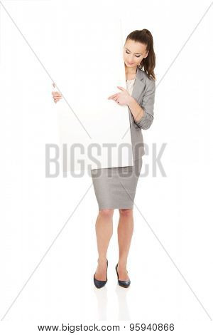 Beautiful business woman presenting empty banner.