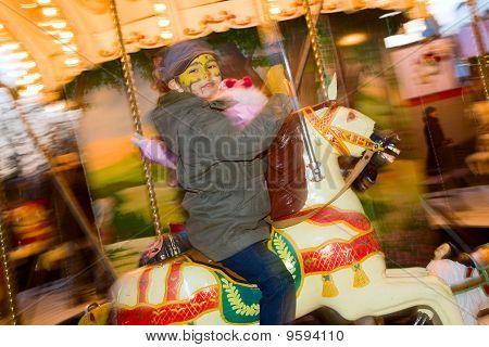 A Boy Rides A Fair Carousel