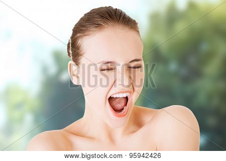 Angry topless woman scream loud.