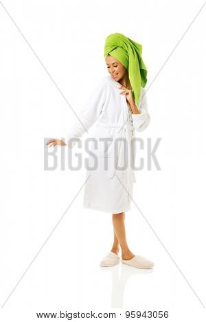 Spa woman in bathrobe and towel on head