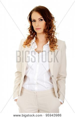 Confident businesswoman with hands in pockets.