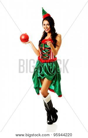 Woman in elf clothes holding christmas bubble