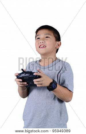 Little Boy Holding A Radio Remote Control For Helicopter, Drone Or Plane Isolated