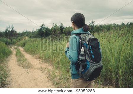 Hiker Girl Walking On Footpath In Summer Forest