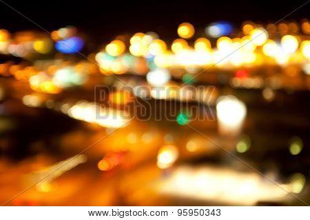 holidays, illumination and electricity concept - golden bright lights on dark night background