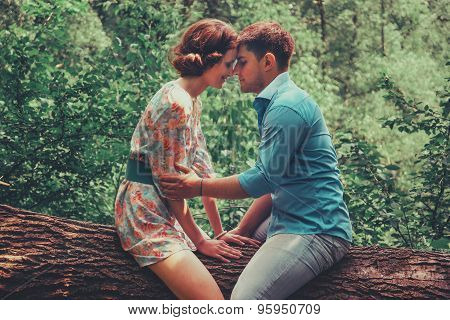 Couple In Love Sitting On Tree In Summer
