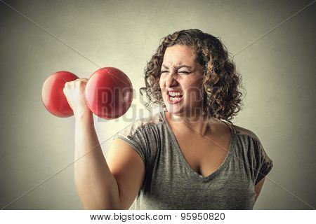 A very strong woman lifting weights
