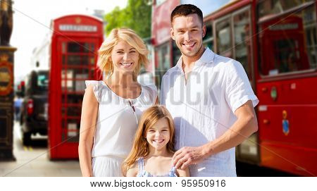 summer holidays, travel, tourism and people concept - happy family over london city street background