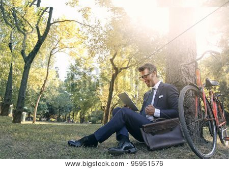 Businessman sitting in the park