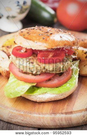 Vegan burger with tomato and lettuce, healthy vegetarian version of classic american fast food