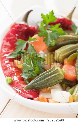 Healthy vegan meal with okra, bell pepper and cooked vegetables