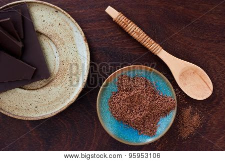 Close Up Of  A Wooden Spoon, Chocolate And Cacao Powder On Wooden Background - Studio Shot  From Abo