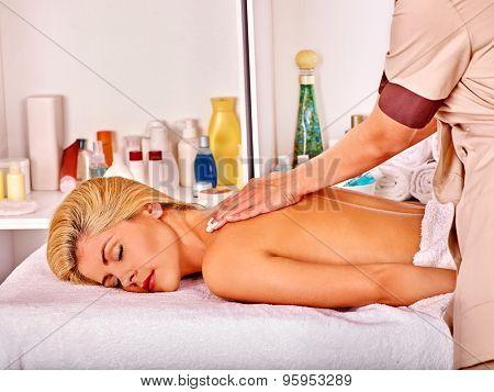 Blond woman sleep and getting massage in health resort.
