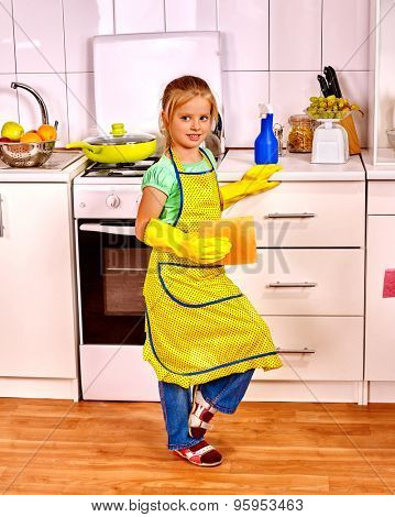 Children cleaning  kitchen. Happy small housekeeping with napkin .