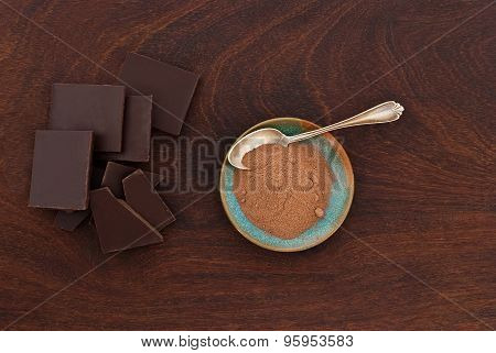 Close Up Of  A Silver Spoon, Chocolate And Cacao Powder On Wooden Background - Studio Shot  From Abo