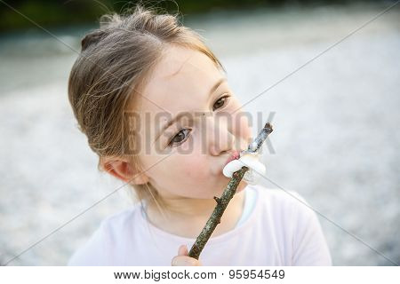 Little Girl Eating Roasted Marshmallow