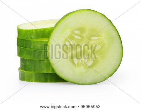 Stack of green cucumber slices isolated on white