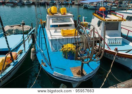 Fishing Boat At Harbor With Nets