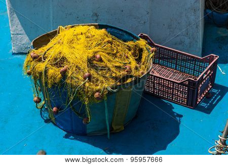 Colorful Fishing Nets And Floats In Basket After Fishing.