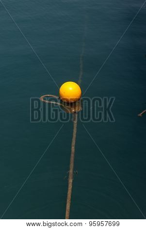 Yellow Buoy On Calm Blue Sea Water Surface
