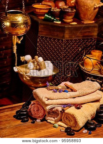 Luxury ayurvedic spa massage still life. Group towel and stone.