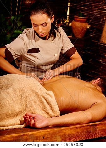 Man  having oil Ayurveda spa treatment. Body part of part.
