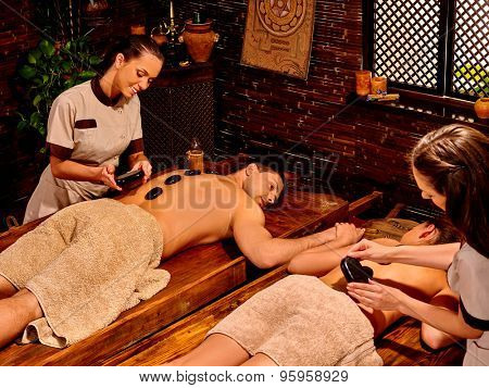 Happy family  having stone Ayurveda spa treatment.